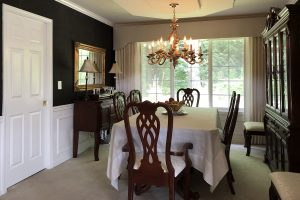 Black grasscloth in the dining room for dramatic elegance.
