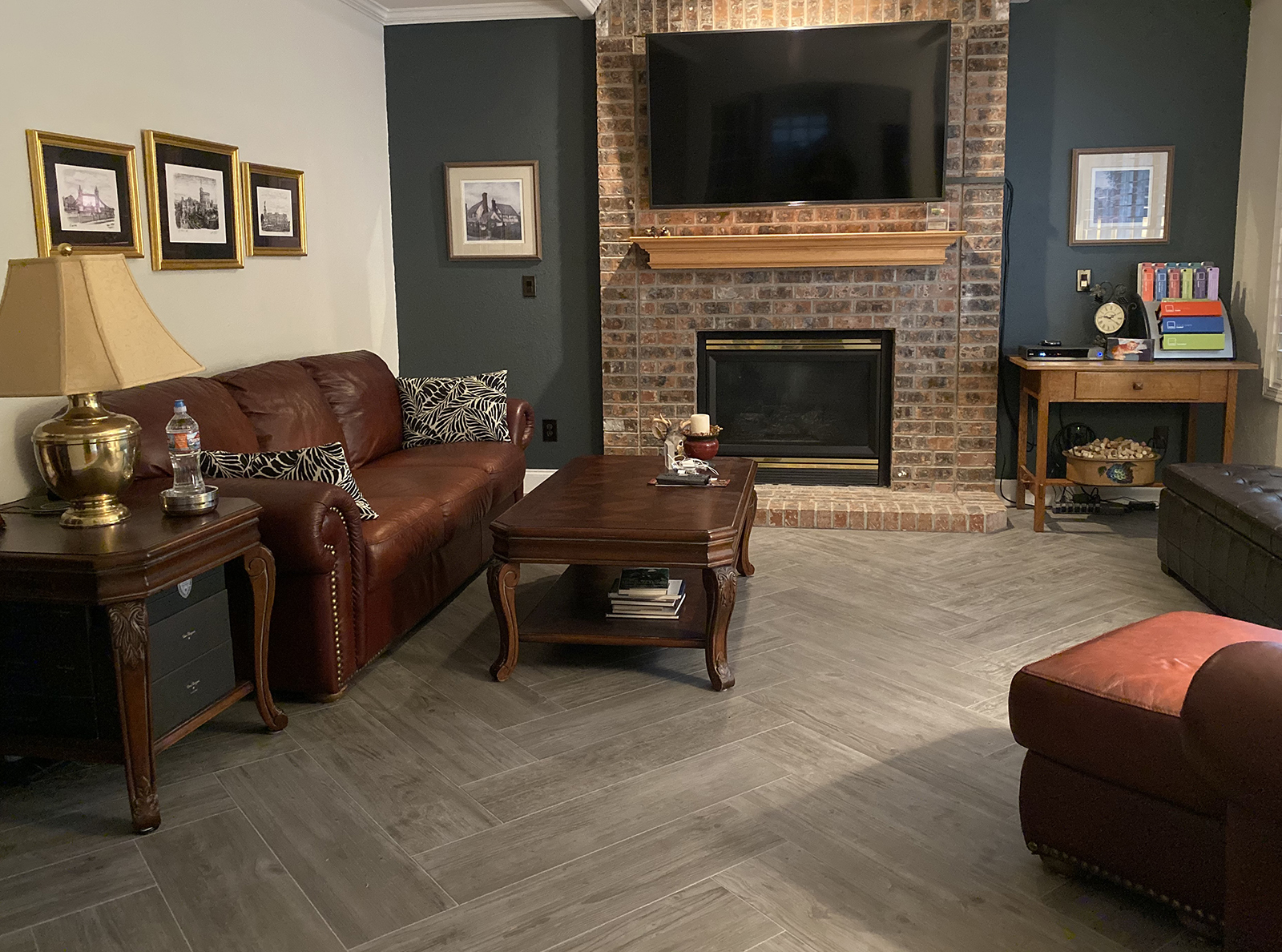 New flooring - porcelain tile in a grey wood grain. It's set in a Herringbone pattern.